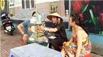 Sao Việt trên Zalo: Đàm Vĩnh Hưng đội nón lá bán bánh ướt