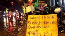 Tấm biển gây bất ngờ giữa phố Sài Gòn ngày mưa lớn